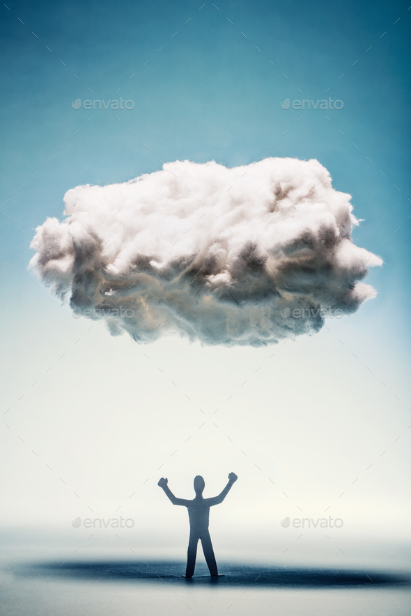 Angry man with clenched fists standing under a cloud. - Stock Photo - Images