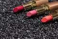 Closeup of lipstick on anthracite surface with copy space - PhotoDune Item for Sale