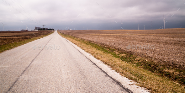 Side Road Harvested Field Farm Agriculture Wind Turbines - Stock Photo - Images