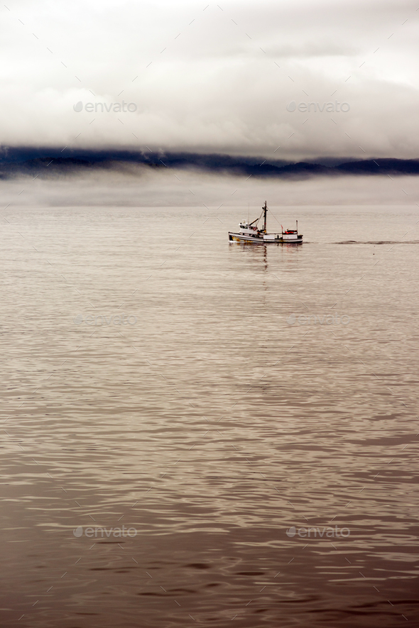 Lone Fishing Boat Motors Out Strait Heading to See - Stock Photo - Images