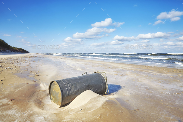 Trash can on a beach, environmental pollution concept - Stock Photo - Images