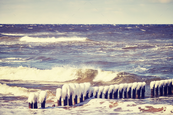 Frozen wooden breakwater on a cold day. - Stock Photo - Images