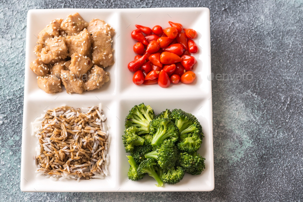 Bowl of broccoli and chili stir-fry on gray background - Stock Photo - Images
