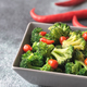 Bowl of broccoli and chili stir-fry on gray background - PhotoDune Item for Sale