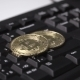 Gold Coin of the Bitcoin Revolves on the Keyboard - VideoHive Item for Sale