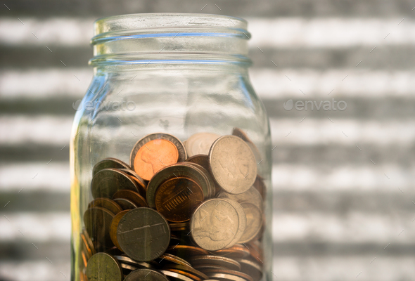 American Dollar Currency Coins in Jar Pennies Nickels Quarters Dimes - Stock Photo - Images