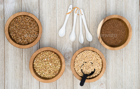 Whole Grains Superfoods Portioned in Ramekins on Wood table - Stock Photo - Images