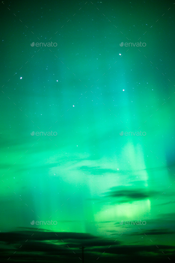 The Aurora Borealis emerges through clouds remote Alaska - Stock Photo - Images