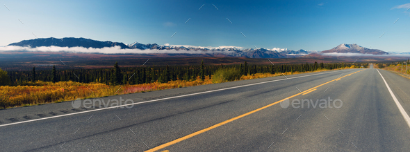 Mountains To Tundra Valley View Two Lane Highway Alaska United States - Stock Photo - Images