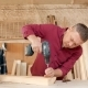 Family, Carpentry, Woodwork and People Concept. Father Teaches Son Carpentry - VideoHive Item for Sale