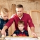 Family, Carpentry, Woodwork and People Concept Father Teaches Son Carpentry - VideoHive Item for Sale