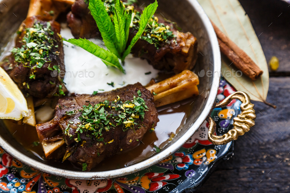 Lamb shanks in coper pan, close view - Stock Photo - Images
