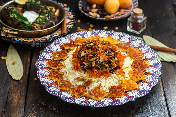 Delicious Iranian jewelled rice topped with nuts, raisins and orange zest - Stock Photo - Images