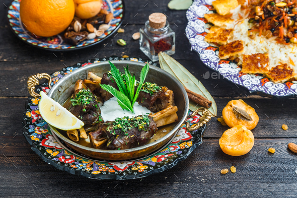 Lamb shanks with yoghurt and mint, arabian style - Stock Photo - Images