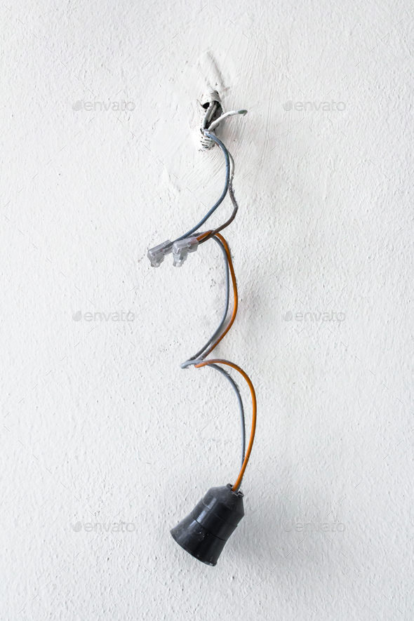 Dangerous bad wiring leading to the bulb - Stock Photo - Images