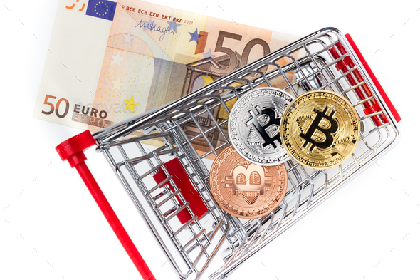 Image of bitcoins in shopping cart on euro bill - Stock Photo - Images
