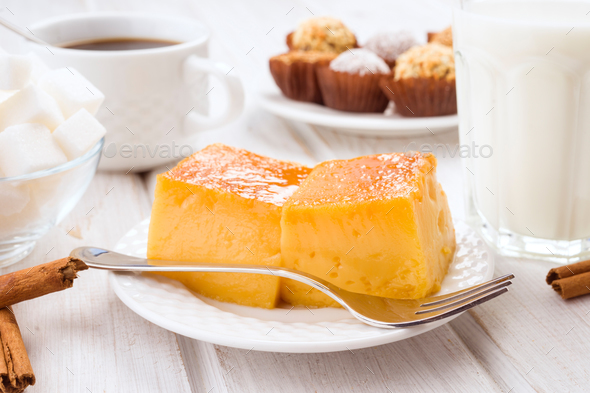 creme brulee tart on wooden table with breakfast - Stock Photo - Images