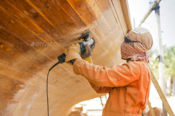 Worker at Abu Dhabi Boatyard - Stock Photo - Images