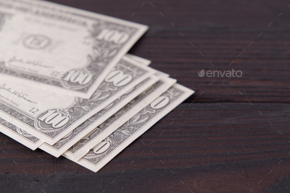Dollar banknotes on a wooden table - Stock Photo - Images