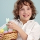A Child Holds a Easter Bunny and a Set of Decorative Easter Eggs. The Boy Laughs Cheerfully. - VideoHive Item for Sale