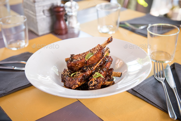 Dish of marinated spicy pork ribs - Stock Photo - Images