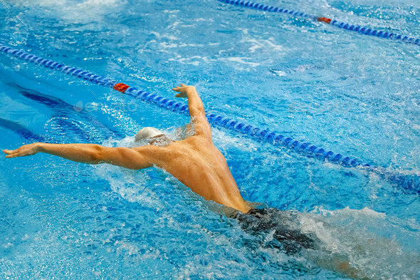 back male athlete swim butterfly - Stock Photo - Images