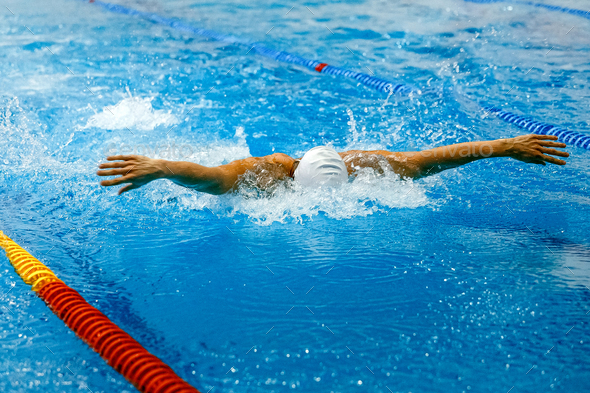 front view swimmer swim butterfly stroke - Stock Photo - Images