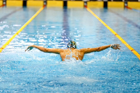 one swimmer athlete swim butterfly stroke - Stock Photo - Images