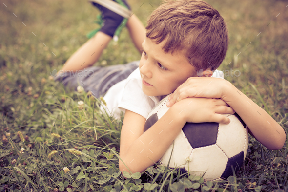 Portrait of a young  boy with soccer ball. - Stock Photo - Images