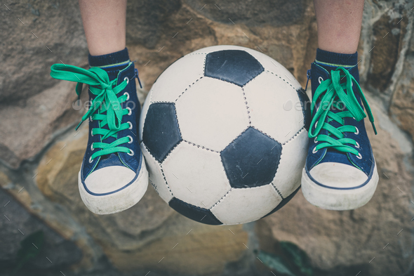 Young little boy sitting  with soccer ball. - Stock Photo - Images