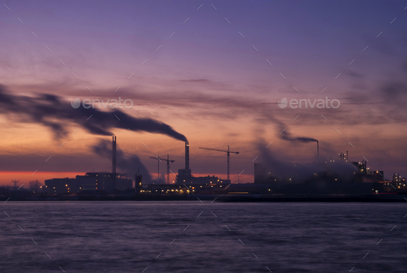 Sunrise above a chemical factory - Stock Photo - Images