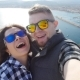 Happy Young Loving Couple Taking Selfie on Mountains near the Sea - VideoHive Item for Sale