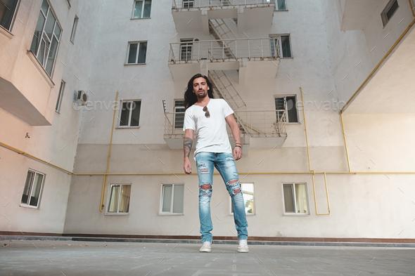 Stylish man posing on building background - Stock Photo - Images