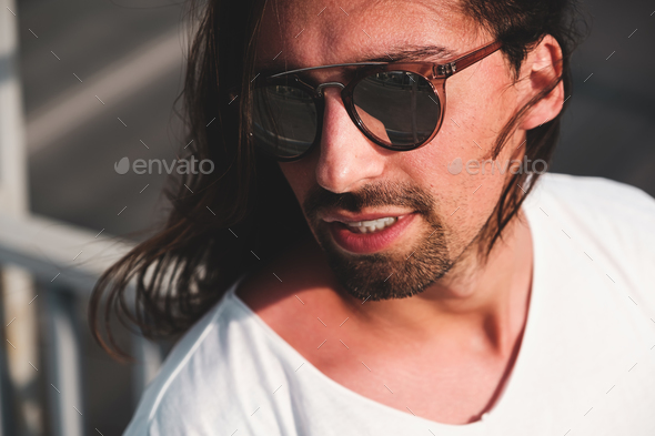 Attractive bearded man portrait wearing fashionable sunglasses - Stock Photo - Images