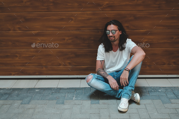 Stylish young man posing with fashionable sunglasses - Stock Photo - Images