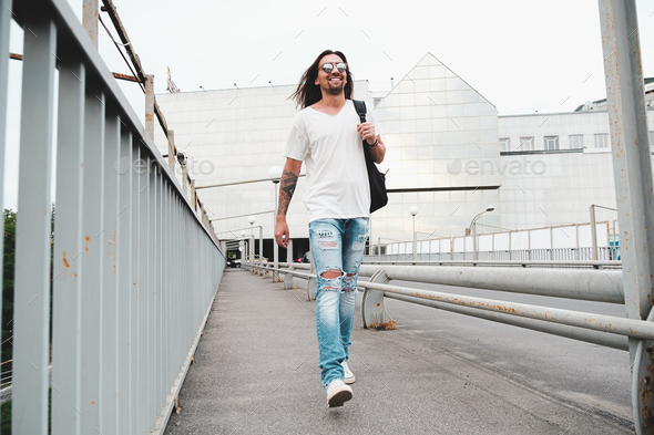 Happy man walking in the city - Stock Photo - Images