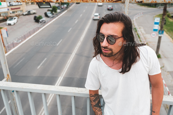 Beautiful man portrait wearing stylish sunglasses - Stock Photo - Images