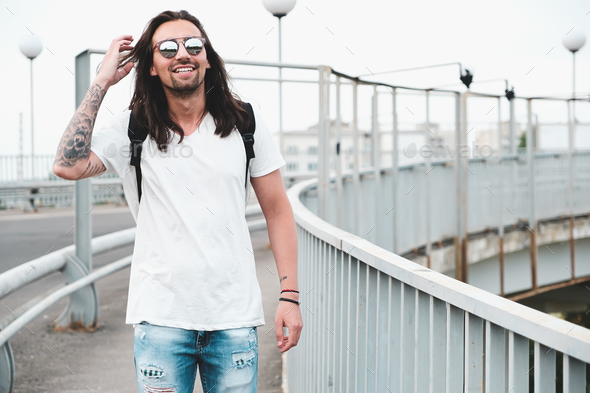 Smiling man hang out, walking in the city - Stock Photo - Images
