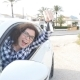 Happy Woman Showing the Key of New Car Outdoors - VideoHive Item for Sale
