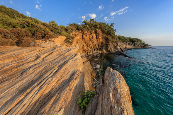Sunrise over the sea and coastline. Thassos, Greece - Stock Photo - Images