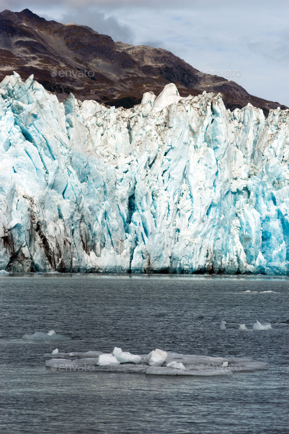 Ice Chunks Dwarfed by Mountains Aialik Glacier Alaska Kenia Fjords - Stock Photo - Images