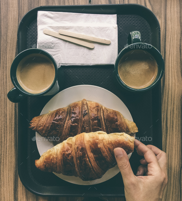 Croissant and  coffee breakfast. - Stock Photo - Images