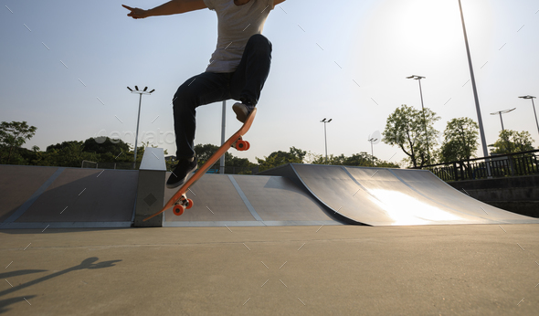 woman skateboarding at skatepark - Stock Photo - Images