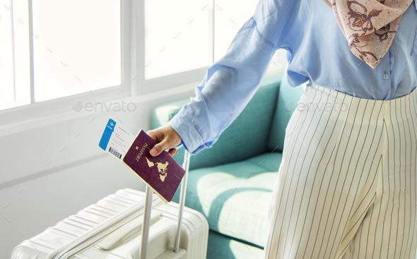 Islamic woman preparing to travel - Stock Photo - Images