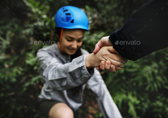 Hand holding hand helping - Stock Photo - Images
