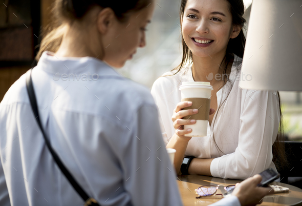 Women enjoy some morning coffee - Stock Photo - Images
