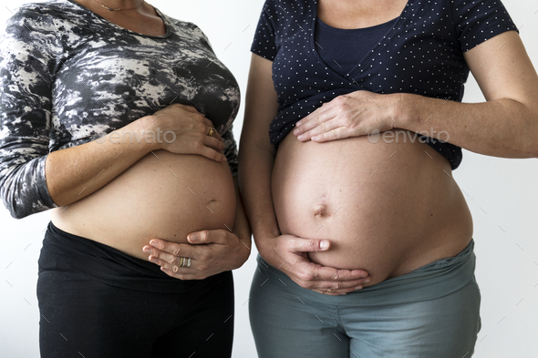 Pregnant women showing their bumps - Stock Photo - Images