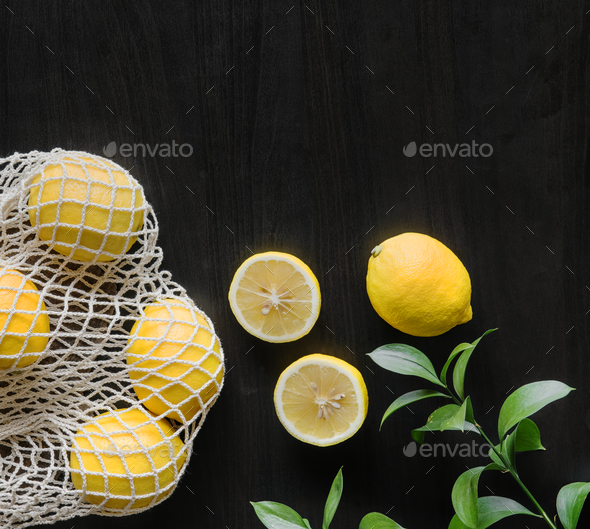 Fresh yellow lemons on black background - Stock Photo - Images