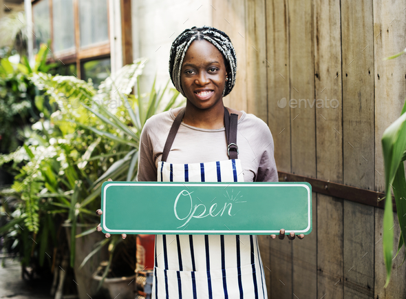 """A person holding an """"open"""" sign - Stock Photo - Images"""