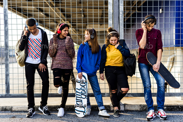 Group of school friends outdoors lifestyle and leisure music concept - Stock Photo - Images